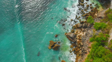 тропики : Aerial view of rocky seacoast with ocean at Padang Padang, Bali. Стоковые видеозаписи