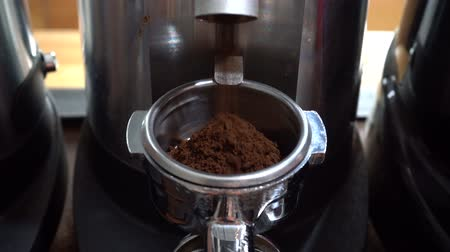 italian speciality : coffee grinder grinding freshly roasted make beans into a powder