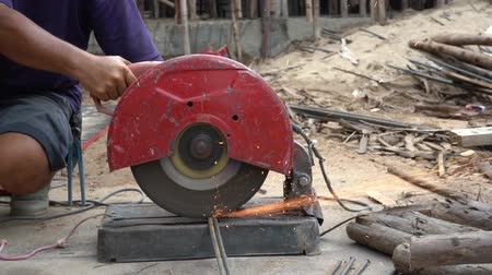 installer : Construction builder worker with grinder machine cutting metal bar at building site