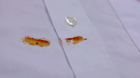 blemished : Ketchup stain on shirt