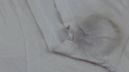 perspiring : Sweat stain on t-shirt