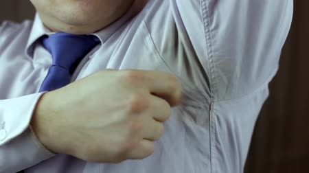 hyperhidrosis : Shirt sweat stain problem Stock Footage