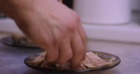 pulling off : Cooked chicken meat being removed from the bone Stock Footage