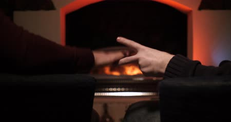 rude : Two guys playing paper, rock, scissors near the fireplace. Stock Footage