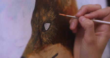 image house : Artist paints picture on canvas with acrylic paints in her workshop. Girl artist draws a fox, picture closeup Stock Footage