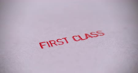 premium : Rubber stamping that says First Class. Stock Footage