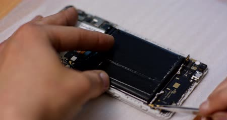 repairer : Repairman disassembling smartphone with screwdriver. Technician fixing broken phone, electronics repair service, repairer pov Stock Footage