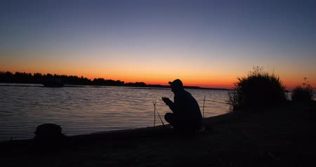 outdoor hobby : Fishers fishing on sunrise Stock Footage