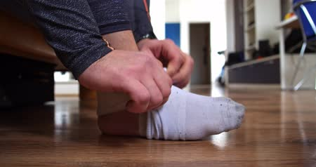 kostka : Man with injured leg wearing a sock