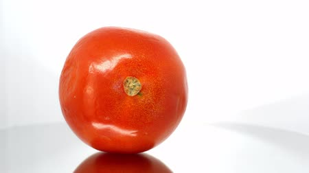 moldy : Spoiled tomato close up on white background Stock Footage