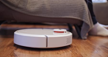 cognac : The robot vacuum cleaner brings a glass of cognac to its owner and takes the empty back