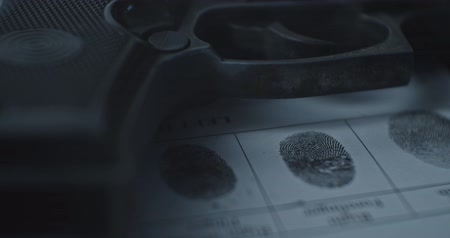 Fingerprints card and gun close up in motion, CSI.