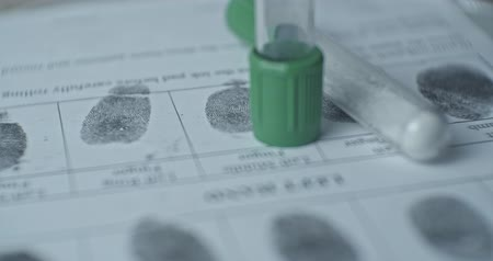 sheriff : Fingerprints card and test tubes close up in motion, CSI.