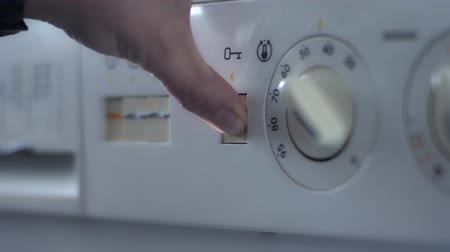 lavanderia : Old washing machine opening by pressing button close up