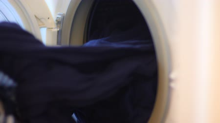 crossed : Washing machine unloading close up Stock Footage