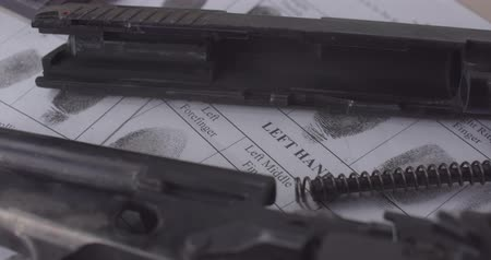 criminology : CSI balistic expertise gun close up