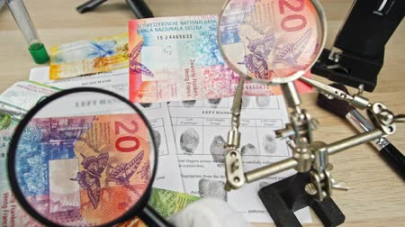forgery : CHF investigation close up, swiss francs, Switzerland