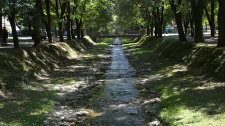Small river flows under a bridge in the city of Vrnjacka Banja in Serbia