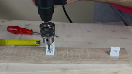 Fastening plastic element to a wooden plank with an electric screwdriver (electric drill)