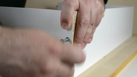 Fastening two particle boards with a screw using Allen key