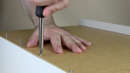 Close-up of screwing a few screws set in a row with screwdriver Stock Footage