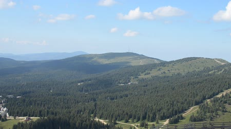 Panning shot from scenic view of the mountain range to ski resort on mountain Kopaonik, Serbia Stock Footage