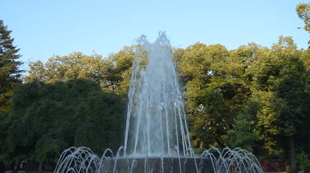 Fountain in a public park changing shapes of spraying water, in Vrnjacka Banja, Serbia, in the morning