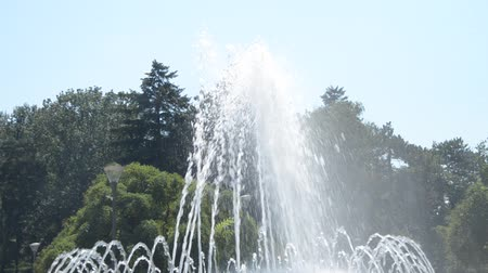 Hand-held shot of water spraying from fountain
