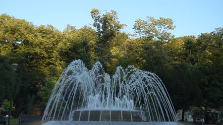 jet out : Fountain in a public park in Vrnjacka Banja, Serbia, changing shapes of spraying water, early in the morning