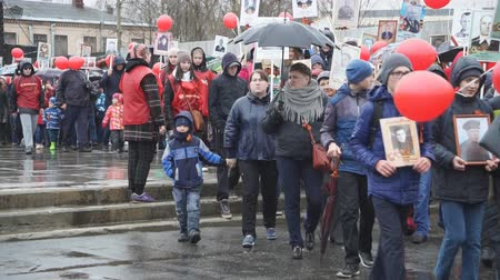 yearbook : Russia Berezniki may 9, 2018: people take part in a memorial demonstration of the Immortal regiment with portraits of their relatives who participated in the second World war.
