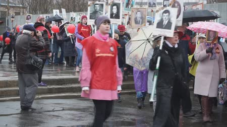 stalin : Participants of the Immortal regiment carried out the portraits of their relatives who participated in the Second World War - Russia Berezniki may 9, 2018.