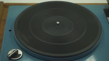 Vinyl rotating on a turntable, top view