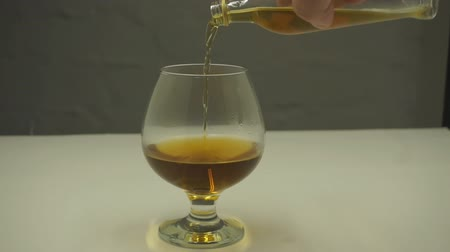 endless gold : Whiskey is poured into glass in slow motion.