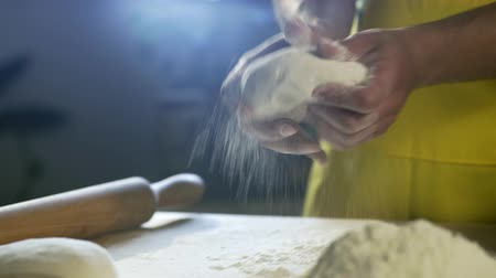 peperoni : Chef hands preparing dough for pizza on table in kitchen 4K