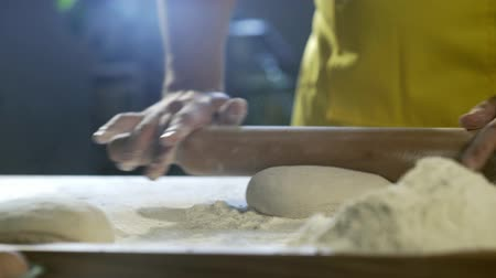 salame : Chef hands preparing dough for pizza on table in kitchen 4K