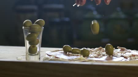 chilli sauce : Young chef put olives on pizza HD Stock Footage