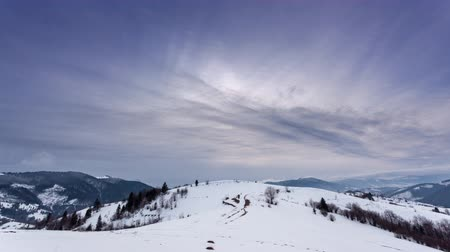 christmas background : Mountain peak with snow blow by wind. Winter landscape. Cold day, with snow.