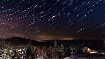 Stars Moving Above Small House In The Mountains In WInter. Ukraine, Carpathian