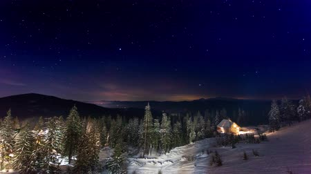 созвездие : Stars Moving Above Small House In The Mountains In WInter. Ukraine, Carpathian