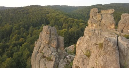 carpathian : Aerial spectacular view to Tustan fortress at evening sun-archaeological and natural monument of national significance, popular tourist landmark. Urych, Carpathian Mountains, Ukraine