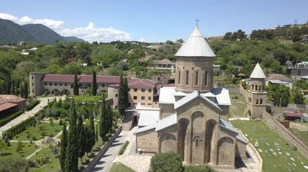 Aerial view to Transfiguration Church. The Pastor of the Thirteen Syrian Fathers. Mtskheta, Georgia Wideo