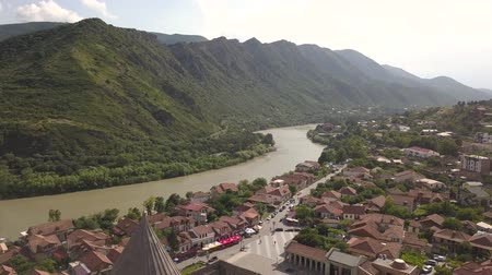 Historical touristic town Mtskheta, near Tbilisi, Georgia. On background mountains and river Aragvi