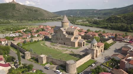 gürcü : Aerial Svetitskhoveli Cathedral and Mtskheta near Tbilisi Georgia Stok Video