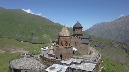 Aerial view of the Holy Trinity Church and the Holy Trinity Church, under Mount Kazbegi, Georgia Wideo