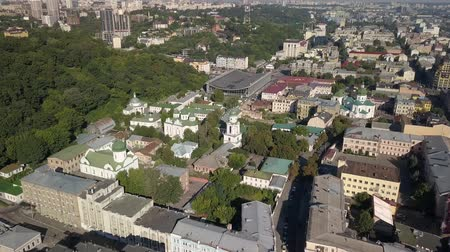 летчик : Famous touristic places in Kyiv - Aerial view Monastery Sts. Florus and Laurus at Podil region, Kyiv, Ukraine Стоковые видеозаписи