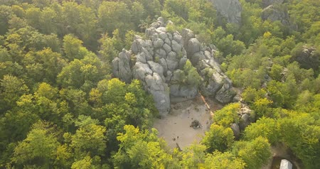 legendary : Aerial view to Dovbush Rocks in Bubnyshche at sunrise - a legendary place, the ancient cave monastery in fantastic boulders amidst beautiful scenic forests, popular with tourists and travelers in Eastern Europe and Ukraine Stock Footage
