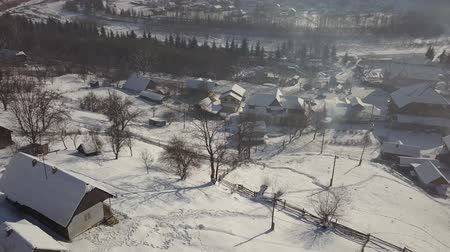 Карпаты : Calm and cosy fairy-tale village Kryvorivnia covered with snow in the Carpathians mountains, aerial view