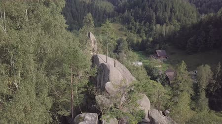 skalní útes : Aerial view stone rocks Ternoshorska Lada amidst beautiful scenic Carpathian mountains and forest. Symbol of motherhood and fertility, Kosiv Region, Ivano-Frankivsk Oblast, Ukraine
