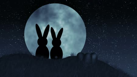 coelho : Easter Bunnies on Hill in front of giant moon