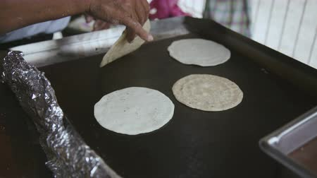 országúti : Spanish woman making fresh tortilla bread on a hot plate